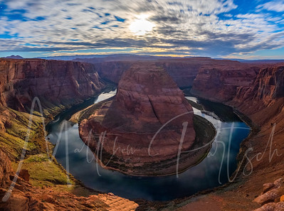 Full Moon Setting over horseshoe bend in Page, Arizona.  There is no sunlight in this image, only moon light reflecting off of the rocks