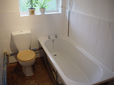 Bath Wall Complete  And the bath and window walls.  The bath has also been sealed in with silicon sealant.