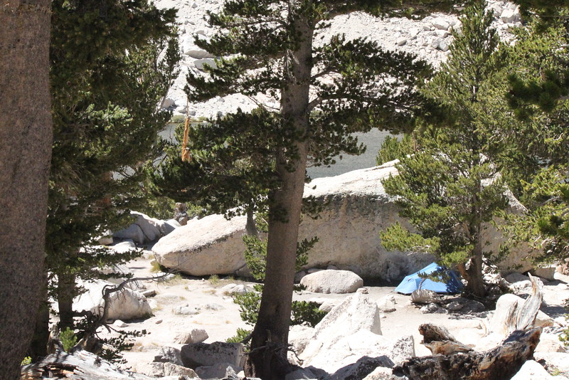 A secluded tent, protected from the wind and in view of one of the Cottonwood Lakes.