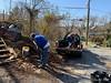 Jim D mixing dirt, Steve H. shoveling compost out of truck