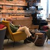 Older hipster lounging in Draw wine bar and cafe in Trieste, Italy