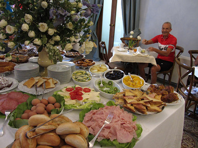 Polo helps himself  to the beautiful breakfast buffet at Hotel del Carmine in Marsala.