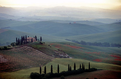 Wake up to a view of the misty Tuscan hills of the Orcia Valley