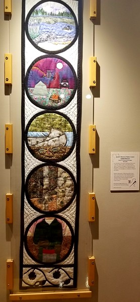 Quilt banner commemorating historic events