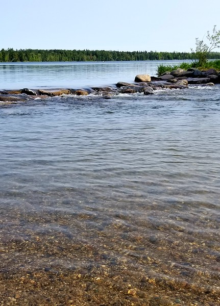 Waters of Lake Itasca pass over rocks to become the very beginning of the Mississippi