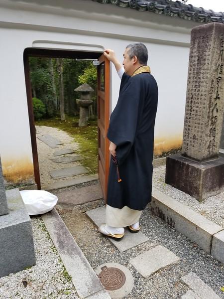 Monk at door to interior garden
