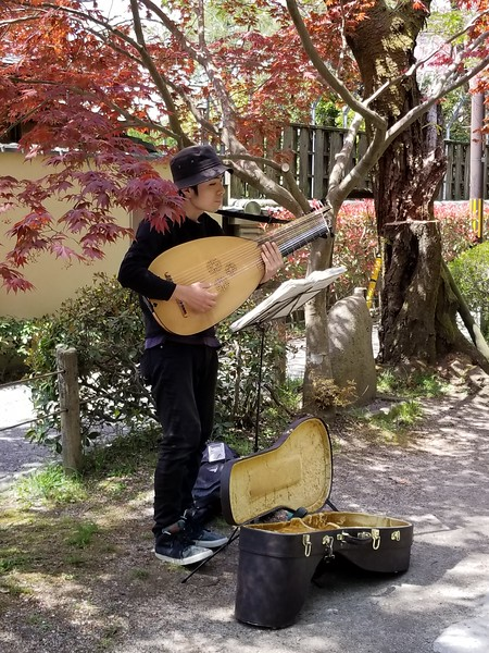 Busker playing some sort of lute