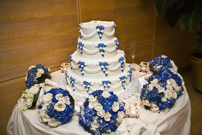 The wedding cake with the bridesmaids' flowers - Washington, DC ... April 26, 2008 ... Photo by Holland Photo Arts