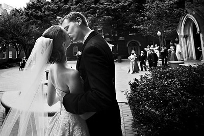 Sneaking a kiss before everyone comes out - Washington, DC ... April 26, 2008 ... Photo by Holland Photo Arts