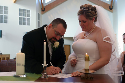 Sam signing the marriage certificate