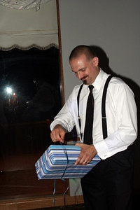 Dave opening his groomsmen's gift.
