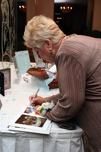 Mother of the Bride signing the guest book.