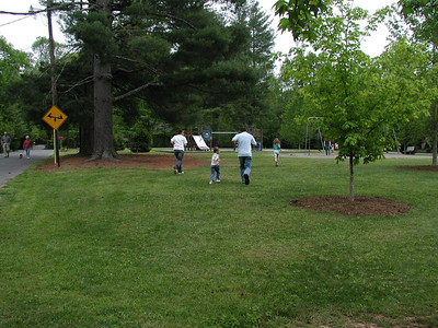 Elisabeth, Eli, Michael and Summer running to the park.