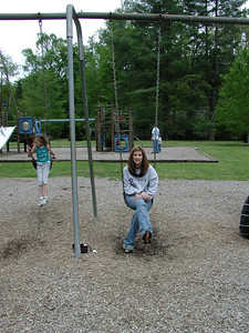 Cara and Summer on the swings.