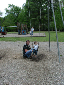 Tate and Chris at the swings.