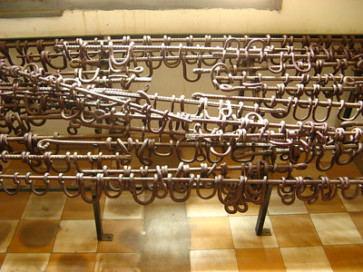 These bars shackled the ankles of dozens of prisoners as they lied on the ground in the rooms