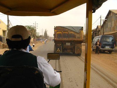Our slow Tuk Tuk stuck behind a truck