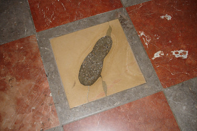 "This is the ""Devil's Footprint"" in the Cathedral. It is said that the devil stomped his foot here because he bet the architect that he could not build a cathedral without windows. From the entrance of the cathedral the columns cover the windows so it appears that there are none. The devil thought e had lost the bet and stomped his foot in frustration."