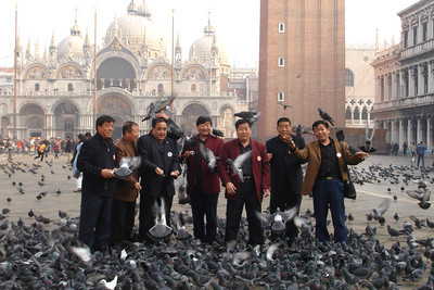 This was one of Sara's favorite photos of the trip so far. These Chinese men were posing for their camera, not ours, but we had to snap a photo as well. This photo tells many stories at once. First, there are way too many pigeons in San Marco Square (flying rats, as our friend Kathleen calls them). Second, if you buy a bit of bird food from a vendor (1 € only) the pigeons will attack you. Third, San Marco church is beautiful.      Tour groups from Asia, especially Taiwan, Japan and China, have been a constant presence on our trip and we have come to enjoy running into them. They are very nice people to visit sites alongside because for the most part they are good tourists. They listen very intently to everything their guide has to say and they appear to be really enjoying themselves. The people traveling more independently who we have had a chance to meet are very nice.     For some reason unknown to us, we see a lot of older Chinese men traveling together in men-only tours. It is as common as the older American women travelling together in women-only tours. This was one of those groups. Really, you can't arrange pictures this good.