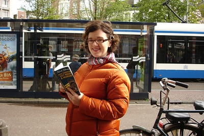 Waiting for a tram to downtown Amsterdam during our Rick Steves self-tour. When you are in Amsterdam you must watch for bikes, motorcycles, trams and cars and amazing thing is, it's ok not to wear helmet