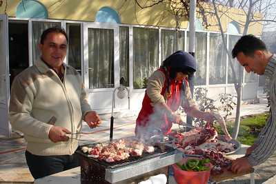 The owner of the guesthouse with his brother-in-law and sister-in-law barbequeing the lamb that was slaughtered to commemorate Eid al Hajj.