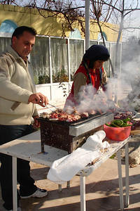 The owner of the guesthouse with his sister-in-law barbequeing the lamb that was slaughtered to commemorate Eid al Hajj.