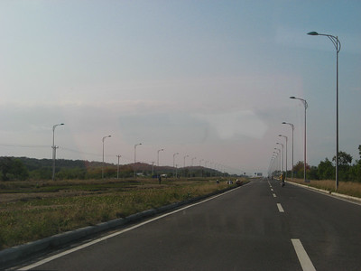 Very nice highway for Vietnam! Four lanes and lights...