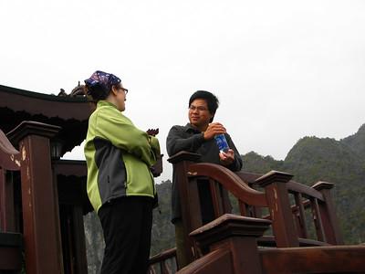 Sara talking with Trong, Huong's husband