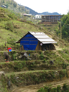 Rice Paddies and house of Black Hmong villager