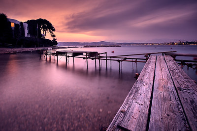 Old pier at the coast of the French Riviera during sunset