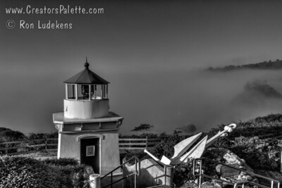 Memorial Lighthouse and bell overlooking Trinidad harbor in Trinadad, California honoring sailers lost at sea.