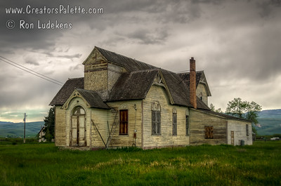 Returning from the Tetons, drove down Hwy 89 through Wyoming and crossed the corner of Idaho to Utah. Saw this boarded up home/church/LDS Stake House just as the highway made a right turn through downtown Ovid, ID. Not much of a town anymore, but this building had character and the storm clouds and newly falling rain made it even more interesting or sinister.