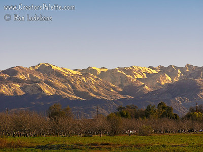 Snow capped Sierra Nevada mountains looking up into the Kaweah River watershed.  Taken from Visalia, California.
