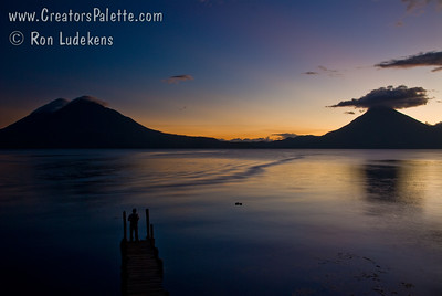 Sunset over Lake Atitlan from Panajachel, Guatemala.   San Pedro Volcano on right with interesting cloud and Toliman Volcano with Atitlan Volcano behind it on left. Guatemala Mission Trip - Day 6 - Wednesday, November 14, 2007