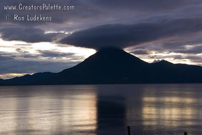 Sunset over Lake Atitlan from Panajachel, Guatemala.   Interesting cloud cap over San Pedro Volcano. Guatemala Mission Trip - Day 5 -  Tuesday, November 13, 2007