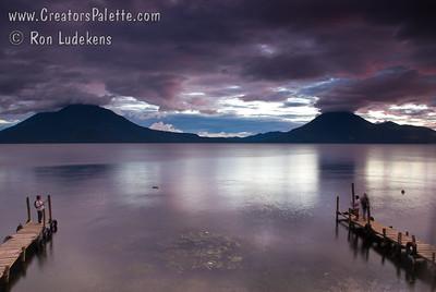 Sunset over Lake Atitlan from Panajachel, Guatemala.   Toliman Volcano with Atitlan Volcano behind it on left, San Pedro Volcano on right. Guatemala Mission Trip - Day 5 -  Tuesday, November 13, 2007