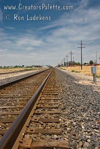 Railroad track near Pixley, CA while waiting for Union Pacific EC-4 maintenance track geometry car to pass by.