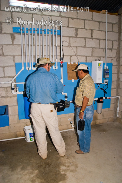 Training the trainers.<br /> Newly trained trainer explaining the clean water system to camp Administrator in preparation for tomorrow's dedication.  Best way to learn is to teach it to another.<br /> Guatemala Mission Trip - Day 6 - Wednesday, November 14, 2007