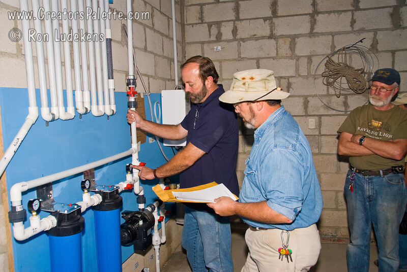 Training the Trainer.<br /> Team leader, Mark, explaining the clean water system to resident missionary, Johnny Coker, in preparation for tomorrow's dedication. <br /> Guatemala Mission Trip - Day 6 - Wednesday, November 14, 2007