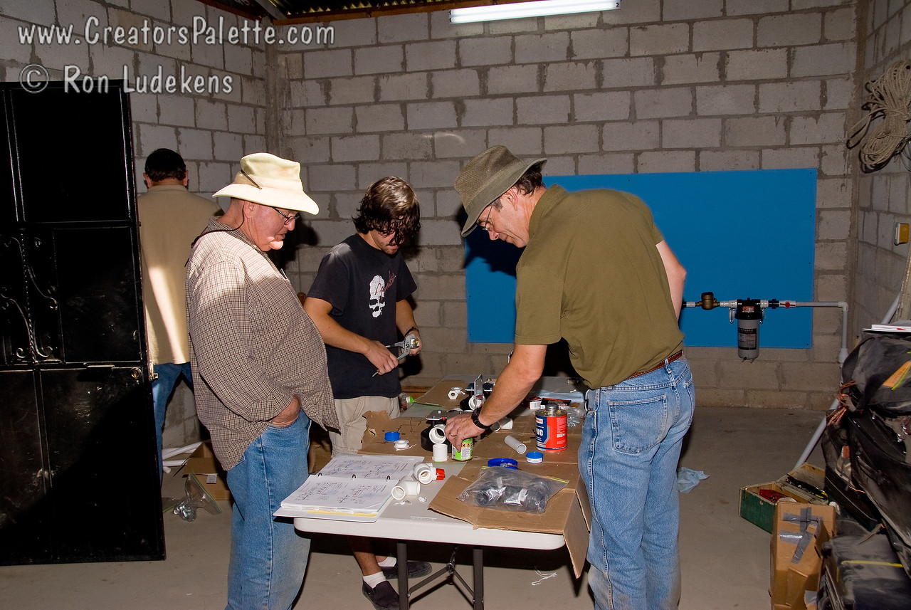 Jordan and Dave assembling the first filter (Trash filter) components.<br /> Guatemala Mission Trip - Day 4 - Monday, November 12, 2007