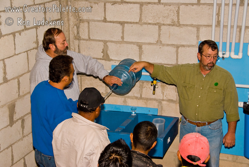 Sanitation<br /> Full demonstration of Clean Water System to third of three groups.  Explained how to sanitize their water bottles before filling with clean water.  This group made up of many family members and wives and mothers was very interested and asked questions.<br /> Guatemala Mission Trip - Day 7 - Thursday, November 15, 2007.  Dedication Day.
