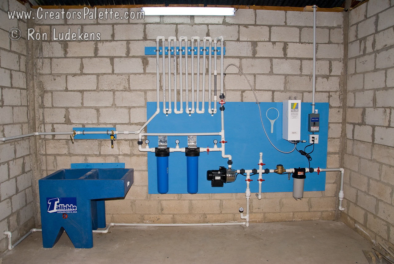 Clean water system installed by First Pres Church at Centennial Camp in Sololá, Guatemala - November 2007.<br /> <br /> Standard Clean Water System:<br /> Purpose: Bacteriological disinfection; removal of chlorine resistant organisms.<br /> Design: Batch treatment process with an integrated bottling station.<br /> Capacity: Based upon tank size; typically a 300 gallon tank.<br /> Process Time: 300 gallons per hour at 5 gpm per batch.<br /> Key Methods: Filtration, micro filtration and ozone disinfection.<br /> Installation Cost: Hardware - $2,500<br /> Operational Costs which includes replacement costs (excluding labor): per 100,000 gallons: one-half cent to one cent per gallon.