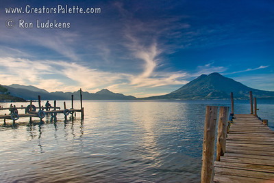 Sunrise along shore of Lake Atitlan in Panajachel.   Two volcanoes - Toliman in front with Atitlan behind it. Guatemala Mission Trip - Day 3 -  Sunday, November 11, 2007