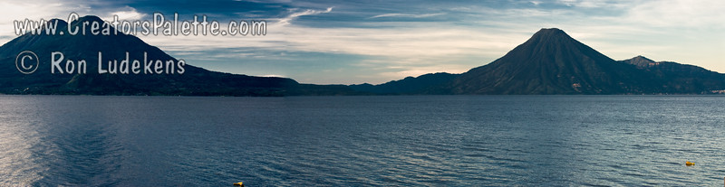 Panorama view of Lake Atitlan at Sunrise from along shore in Panajachel.   Holiman and Atitlan Volcanoes to the left (one behind the other) and San Pedro Volcano to the right. Guatemala Mission Trip - Day 3 -  Sunday, November 11, 2007