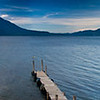 Panorama view of Lake Atitlan at Sunrise from along shore in Panajachel.   Holiman and Atitlan Volcanoes to the left (one behind the other) and San Pedro Volcano to the right.<br /> Guatemala Mission Trip - Day 3 -  Sunday, November 11, 2007
