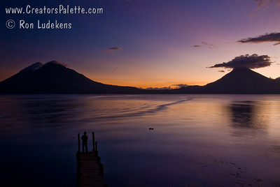 Sunset over Lake Atitlan from Panajachel, Guatemala.   San Pedro Volcano on right with interesting cloud and Toliman Volcano with Atitlan Volcano behind it on left. Guatemala Mission Trip - Day 6 - Wednesday, November 14, 2007