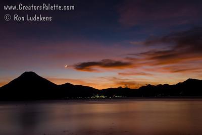 Guatemala Mission Trip - Day 3 -  Sunday, November 11, 2007 Sunset over Lake Atitlan.   San Pedro Volcano visable in silhouette.  Lights are city of San Pedro.