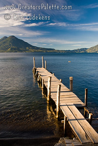 Guatemala Mission Trip - Day 4 - Monday, November 12, 2007 Sunrise and early morning photo of Lake Atitlan at Panajachel.  Holiman Volcano with Atitlan Volcano behind it on left and San Pedro Volcano on right.