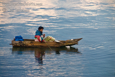 Early morning on Lake Atitlan in Panajachel, Guatemala.  Local fisherman in his boat made of planks.  He did a lot of bailing water. Guatemala Mission Trip - Day 7 - Thursday, November 15, 2007