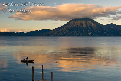Sunrise and Early morning on Lake Atitlan in Panajachel, Guatemala.  Local fisherman in his boat made of planks.  He did a lot of bailing water.   San Pedro Volcano on far shore. Guatemala Mission Trip - Day 7 - Thursday, November 15, 2007
